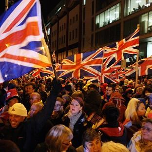 Loyalist protesters carrying Union flags outside City Hall in Belfast