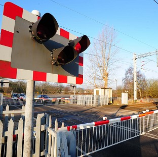 Two women and a child were in a car that was in collision with a train on a South Yorkshire level crossing
