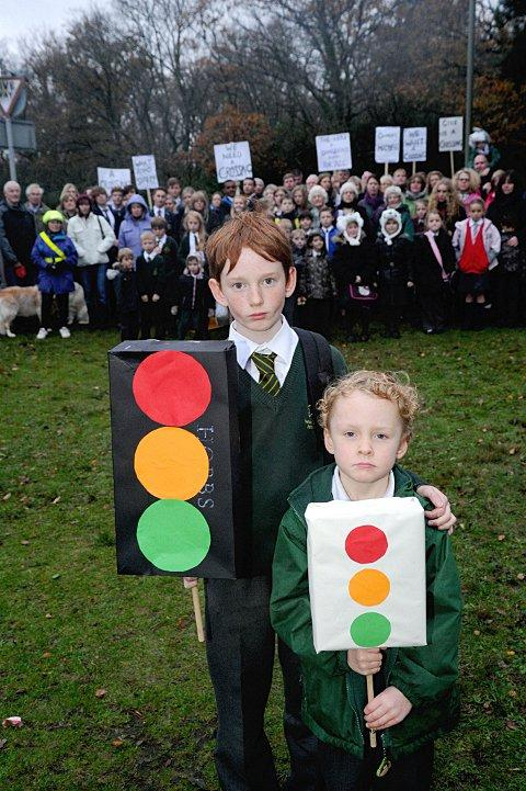 News Shopper: Conor and Eoin Matthews, aged 11 and five respectively, want a pedestrian crossing