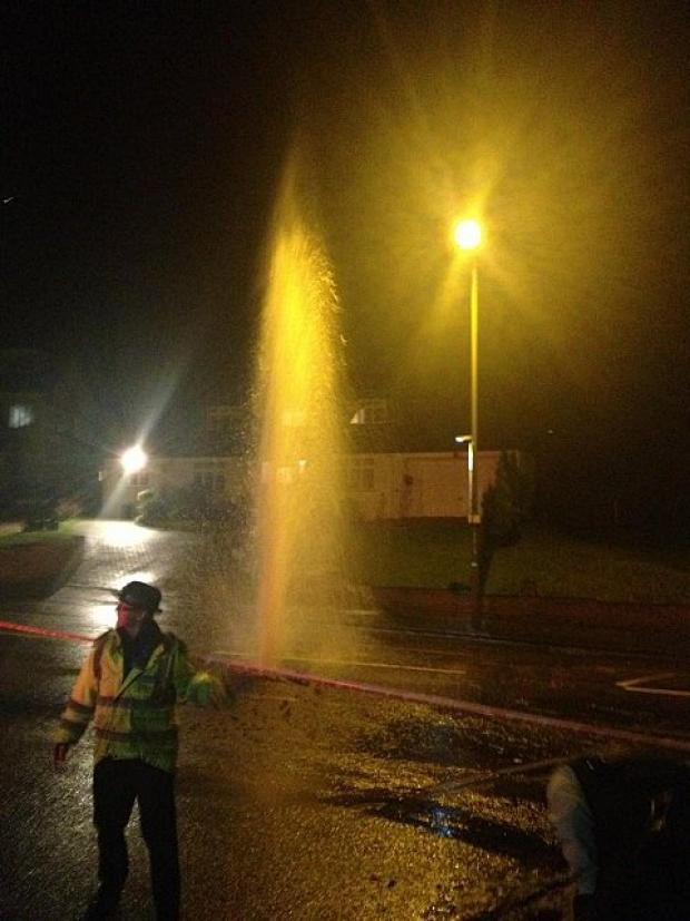 Water spurts out of the main in Elmstead Lane, Chislehurst. Picture by Amy Kenyon
