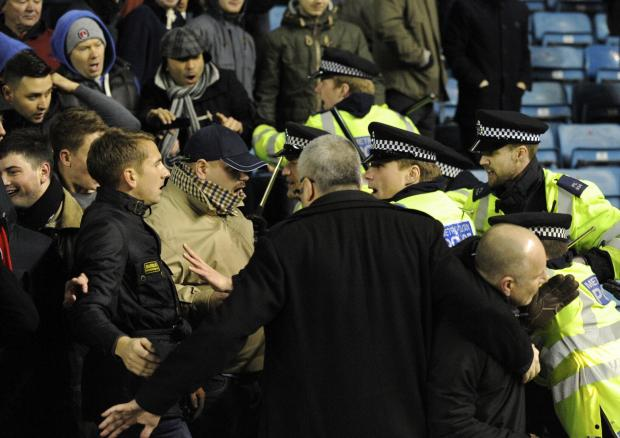 Police move in to the away end at the final whistle. PICTURE BY ALAN STANFORD.