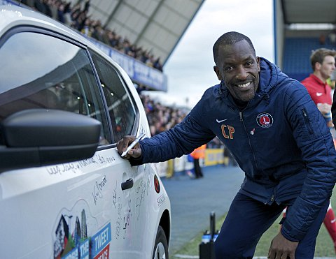 Chris Powell signs the Jimmy Mizen Foundation peace car at Millwall last week. PICTURE BY ALAN STANFORD.