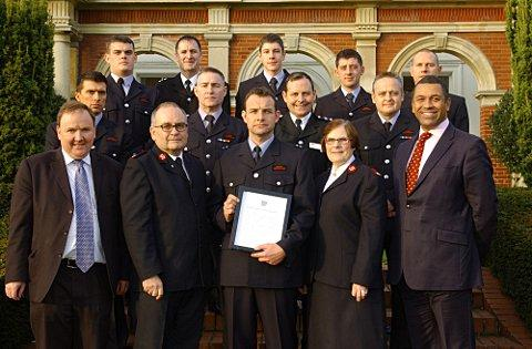 Stephen Gowler (second from front left) is pleased the life saving Bromley firefighters received a commendation