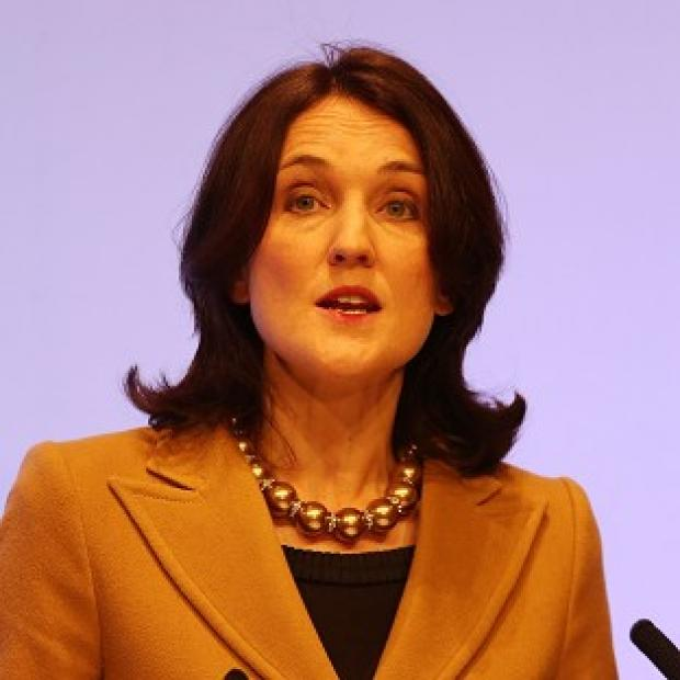 Theresa Villiers has condemned violent protests against Belfast City Council's decision to limit the number of days it flies the Union flag
