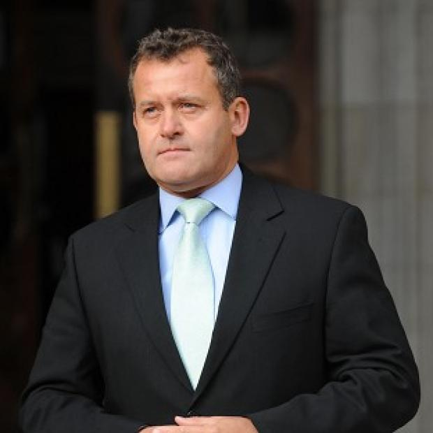 Paul Burrell's lawyer has lodged papers at the High Court alleging breach of confidentiality by Max Clifford