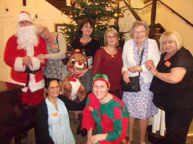 Santa and his elf join Frognal House residents and staff to raise money for the Alzheimer's Society.