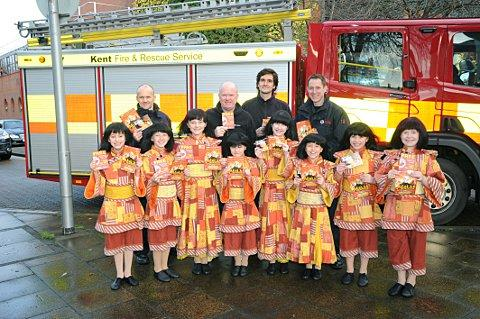 Left to right: firefighters Dave Allen, Chris Bishenden and Lee Abel with Aladdin star Steve McFadden (second left) and the Babes.