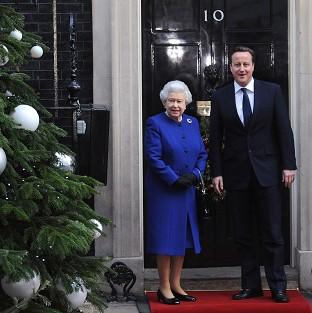 The Queen is met by Prime Minister David Cameron outside 10 Downing Street ahead of the Cabinet meeting