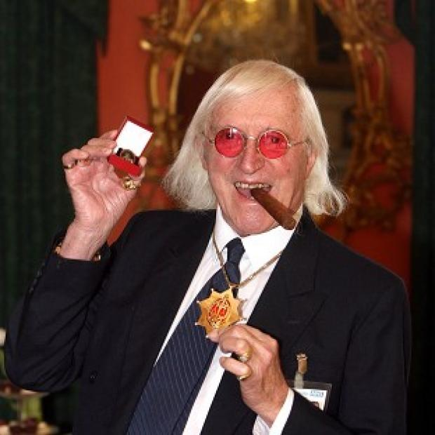 The BBC has denied claims it axed a Newsnight report because it clashed with planned tributes to Jimmy Savile