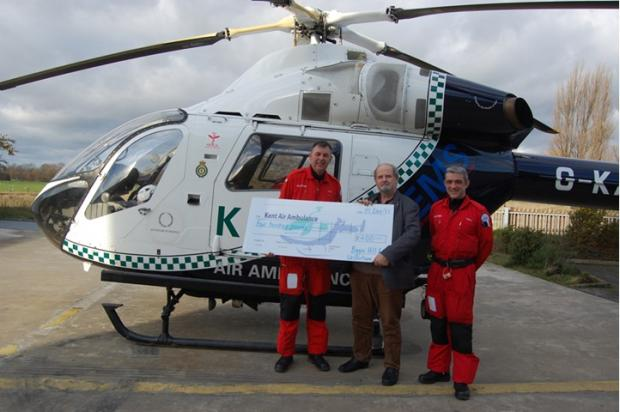 Lion John Scott presents a cheque to Kent Air Ambulance
