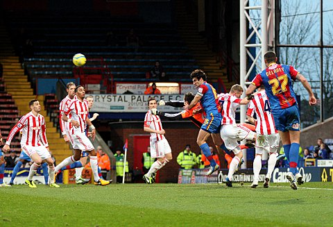 Thomas Sorensen punches clear under pressure from Mile Jedinak