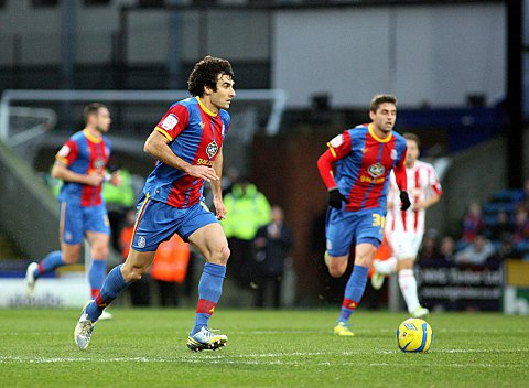 Mile Jedinak drives forward