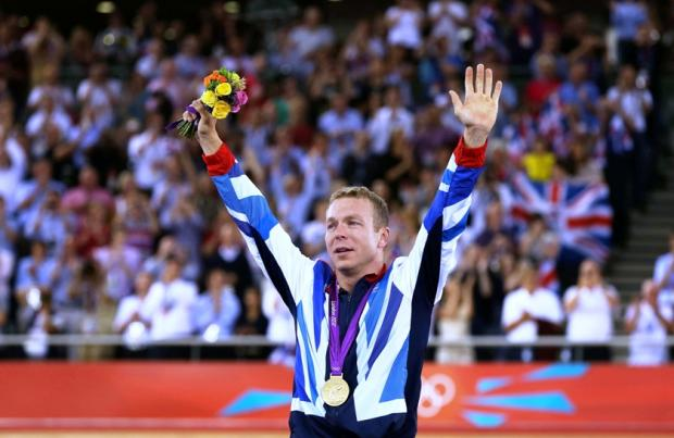 Sir Chris Hoy celebrates winning the gold medal at London 2012 and becoming Britain's most successful olympian