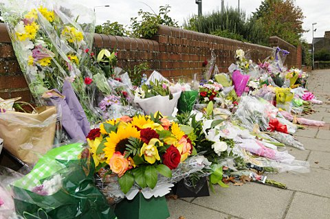 Flowers left at the scene where Sally Hodkin was stabbed