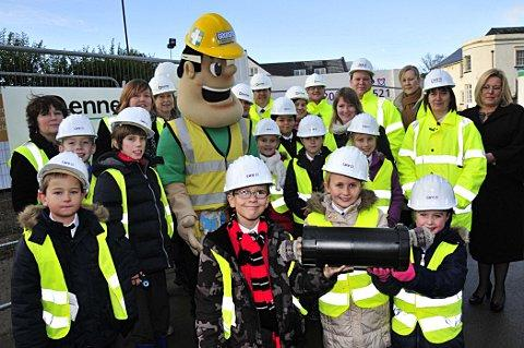 Pupils from Green Street Green and cartoon character, Ivor Goodsite, bury the time capsule at Foxbridge House.