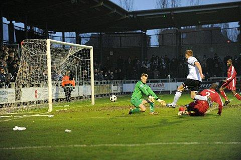 Harry Crawford scores Dartford's fourth
