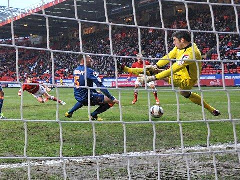 Yann Kermorgant is denied by Matt Gilks' save on Saturday. PICTURE BY KEITH GILLARD.