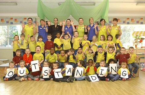 "Staff and pupils at Springfield Lodge Day Nursery celebrate their ""outstanding"" Ofsted report."