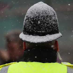 Police are investigating after a man was attacked as he confronted youths who were throwing snowballs at him in Ashford