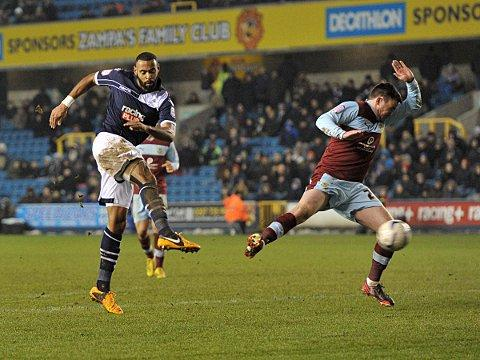 Liam Trotter's shot is blocked by a Burnley defender. PICTURES BY KEITH GILLARD.