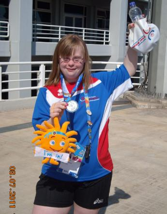 Laura Mitchell, after winning a silver medal in the 4x50 freestyle relay at the Special Olympics World Games in Athens in 2011.