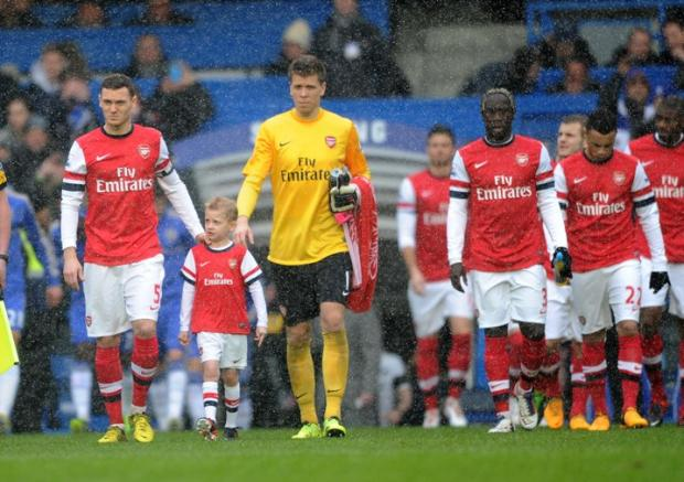 Seven-year-old Callum Pickrell steps out at Stamford Bridge with his Arsenal heroes