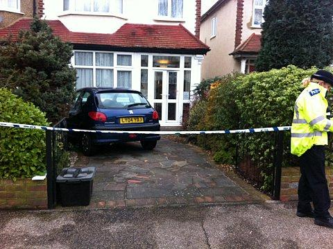 The scene in Ernest Grove this morning, where blood can be seen smeared on the door of the house