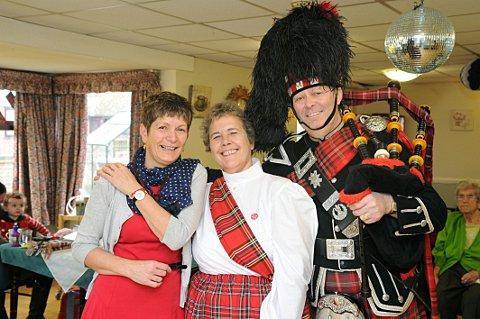 Linda Parker, senior activities co-ordinator, Sue Duffield, chef manager and  piper Richard Jones.