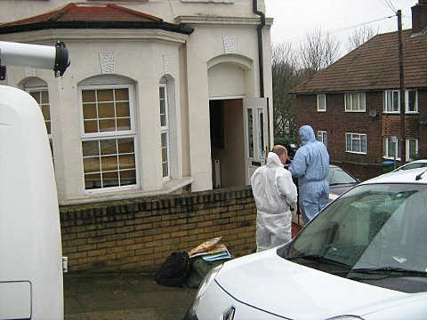 Forensic officers at the scene yesterday
