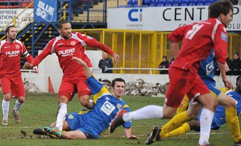 Ross Lafayette scores Welling's winner. PICTURES BY DAVE BUDDEN.