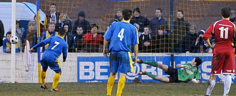 Wes Daly sends his penalty on to the outside of the post with Sam Mott beaten