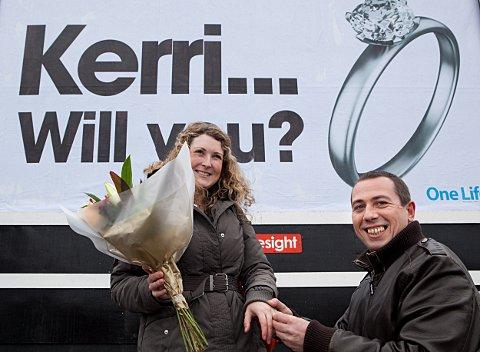 Wayne Eldridge proposes to partner Kerri Grimsley with a message on giant billboards at Charlton's Asda car park