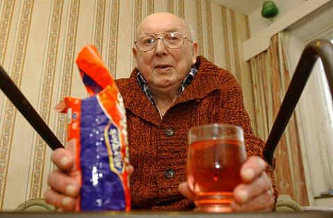 News Shopper: Len Baker with the biscuits and drinks he has to take to bed with him every night.