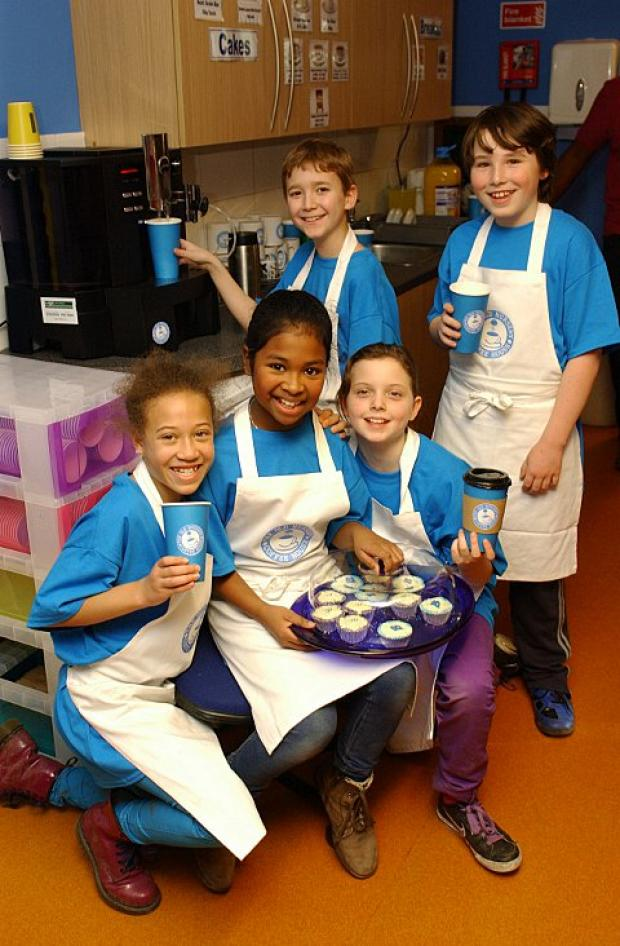 News Shopper: Brooklands Primary School children celebrate launch of their own coffee shop; pictured Matthe