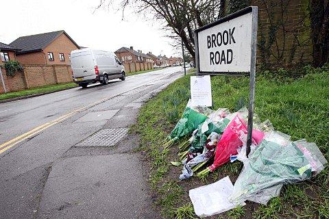 Tributes laid at the scene of the crash at the junction between Brook Road and London Road.