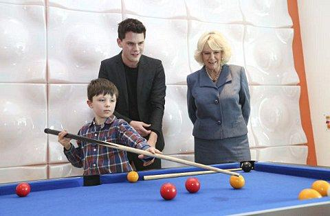 Thomas Sugden, 8, with actor Jeremy Irvine and the Duchess of Cornwall