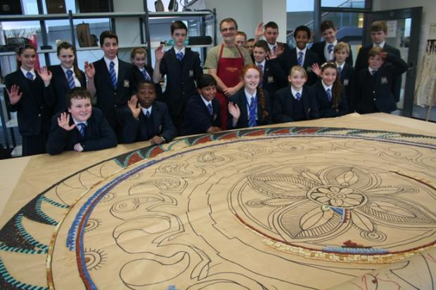Haberdashers' Aske's Crayford Academy pupils with the beginnings of their giant mosaic.