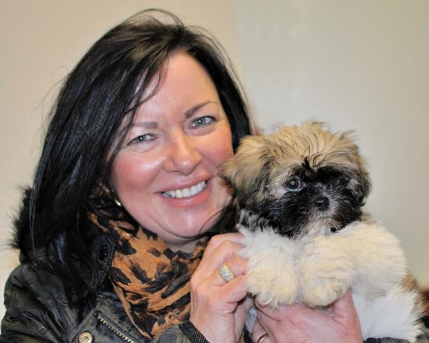 Puppy reunited with shopkeeper Sheri Poole