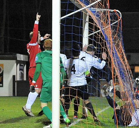 Lee Clarke (left) claims the goal as ball is bundled over the line