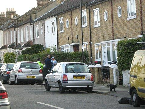 The cordoned off scene in Glenfarg Road where a woman in her 70s was stabbed to death
