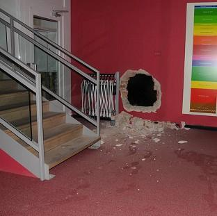 Two thieves chiselled a hole through a brick wall to get in and out of Durham University's Oriental Museum