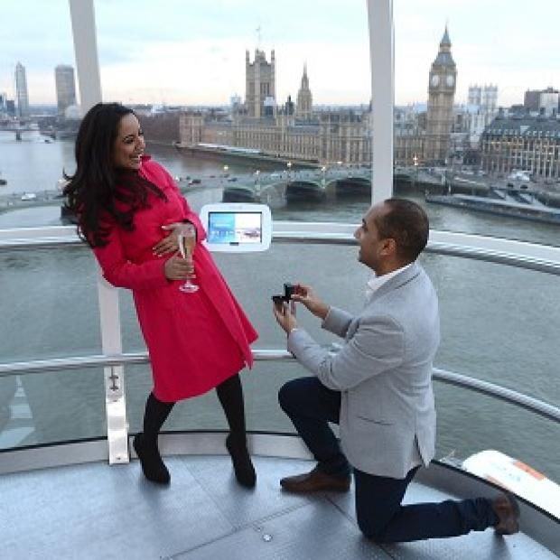 Natasha Palmer and Jagan Rao, from London, who became the 5000th couple to get engaged on the EDF Energy London Eye