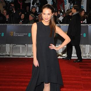 Alicia Vikander arrives for the 2013 British Academy Film Awards at the Royal Opera House, Bow Street, London