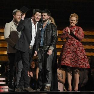 Mumford and Sons accept the award for album of the year from Adele at the 55th annual Grammy Awards on Sunday (AP)