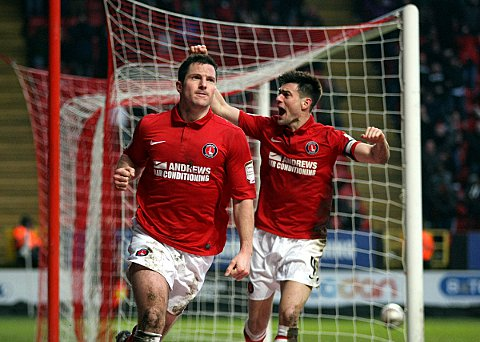 Yann Kermorgant celebrates his 88th minute goal with skipper Johnnie Jackson. PICTURE BY EDMUND BOYDEN.