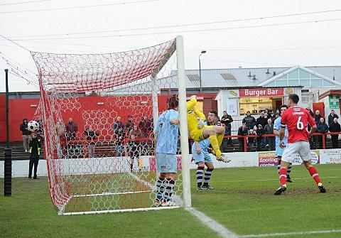 Gateshead keeper Adam Bartlett is beaten by Liam Enver-Marum's decisive third goal for Fleet