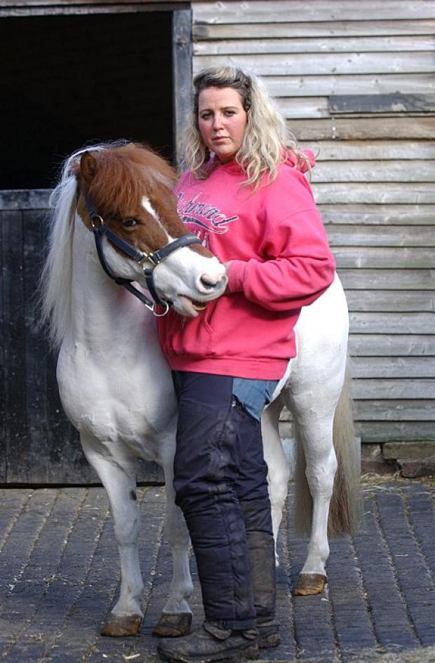 News Shopper: Chloe with Henry - the first horse she rescued five years ago.