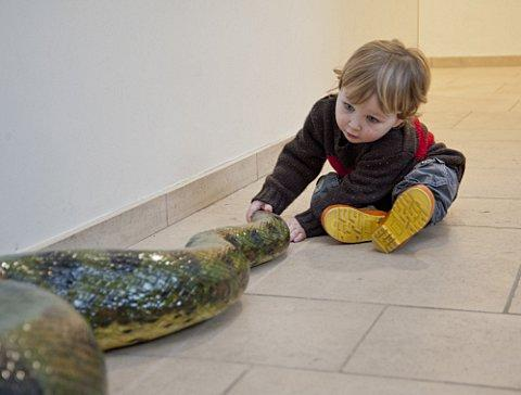 George Green, 22 months, meeting the replica anaconda courtesy of Horniman Museum and Gardens