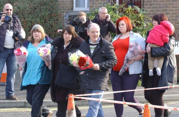 The family of Kevin McKinley lay flowers at the scene of the shooting