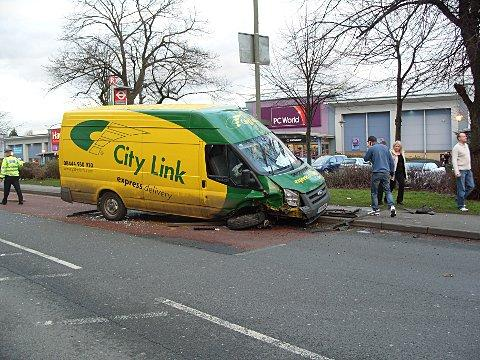 The delivery van hit the bus stop after the collision with the Golf and Fiesta.